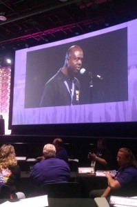 Kwesi Ablordeppey (pictured on the convention monitor) spoke out against racism and other social injustices at the SEIU convention
